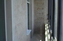 Отделка балкона кафелем